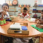 Children at work at big table